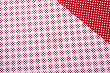 vue de dessus de vive surface rouge et blanche avec motif à pois pour le fond