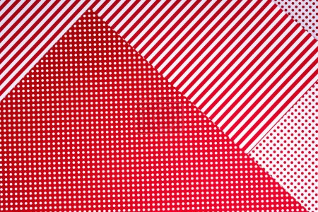 top view of red and white surface with polka dot pattern and stripes for background