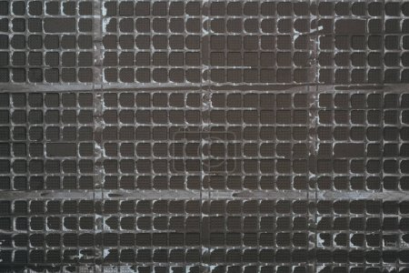 top view of black plastic grid for background