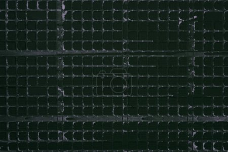 top view of industrial black plastic grid for background