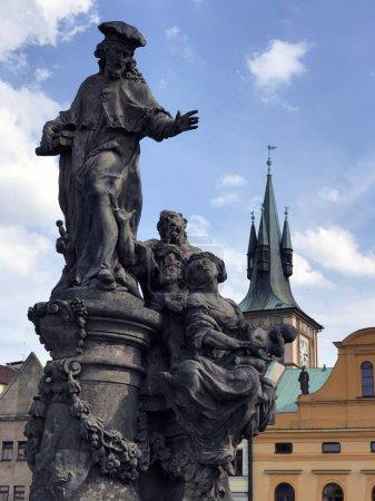 Prague Charles bridge Saint Ivo statue by M.B. Braun. Charles Bridge in Prague.
