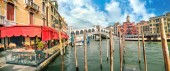 Panoramic view of Grand Canal and famous Rialto Bridge at sunny day in Venice. Italy