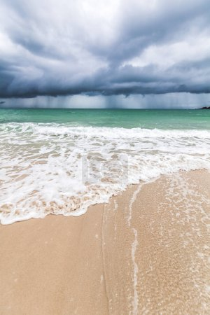 Photo for Storm on a tropical beach, dark storm clouds, beautiful impressive landscape, waves and white sand, climate change - Royalty Free Image