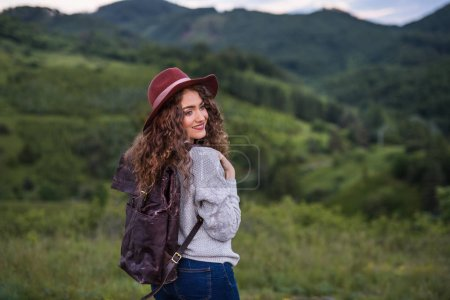Photo for Young happy tourist woman traveller with backpack walking in nature. - Royalty Free Image