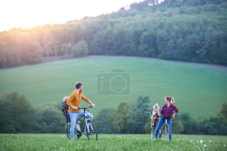 Photo for Family with two small children on cycling trip in nature, having fun. - Royalty Free Image
