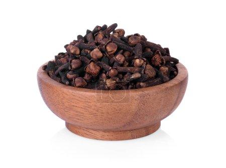 spicy dried clove, syzygium aromaticum flower buds in wooden bowl