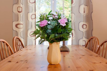bunch of flowers on table on background