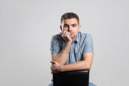 thoughtful  caucasian man posing on grey backgroud