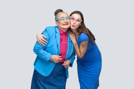 Grandmother with grandchild hugging and have fun together in family, concept of granddaughter with grandmother relationship