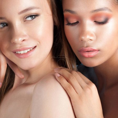 Photo for Caucasian and african teen girls close-up. Skin care and makeup. Mixed race beauty portrait - Royalty Free Image
