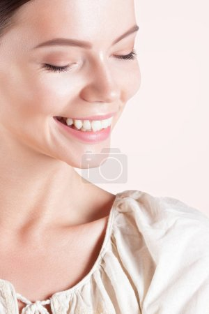 Photo for Young smiling woman with clean perfect skin close-up. Beauty portrait - Royalty Free Image