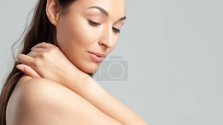 Young beautiful woman with clean perfect skin clos...