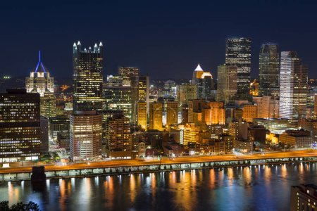 Downtown Pittsburgh at night over the Allegheny River Pennsylvania USA
