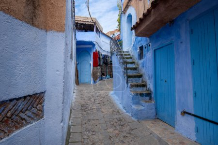 Photo for Beautiful view of the blue city CHEFCHAOUEN, MOROCCO in the medina. Traditional moroccan architectural details and painted houses.  street with door and bright blue walls with arch - Royalty Free Image
