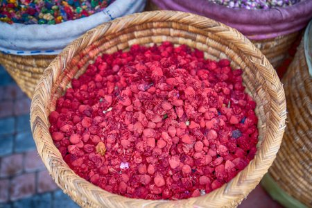 Photo for Baskets of colorful natural organic herbal tea Potpourri in Marrakech market in Morocco. group of beautiful dry colorful flowers. Dried roses , lavender, roselle flower use for decoration mix - Royalty Free Image