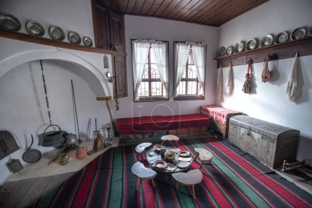 Photo for TRYAVNA, BULGARIA - February 26, 2019: Interior of Museum and School of Carving and Ethnographic Art. Traditional Bulgarian house interior of the 19th century - Royalty Free Image