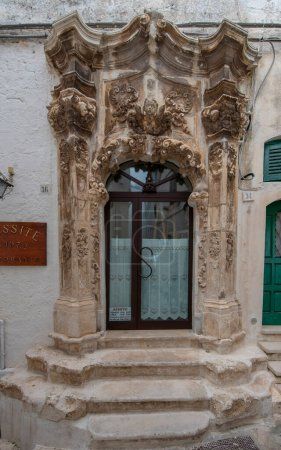 Photo for Facade of a baroque house in Ostuni, Puglia, Italy - Apulia. part of Old wooden  marble door - Royalty Free Image