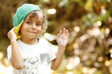 Photo for Funny child in hat. Fashionable little boy. Stylish kid in sunny autumn park - Royalty Free Image