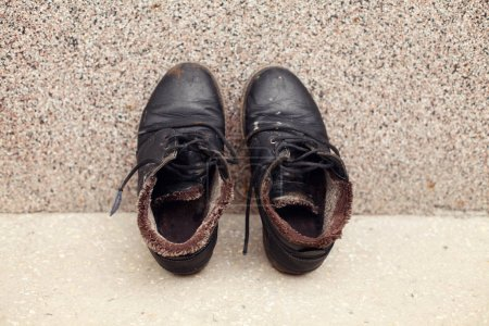Photo for Pair of black shoes near wall - Royalty Free Image