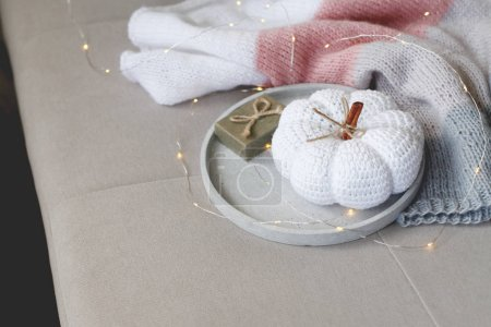 Photo for Still life with present and white knitted pumpkin - Royalty Free Image