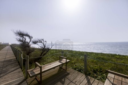 Photo for Praia do Aterro Beach discloses a very extensive sand of about 1,1 Km, situated opposite to refinery industrial complex of Matosinhos.Rocks scattered offshore can cause some sea agitation, attracting many surfing fans. - Royalty Free Image