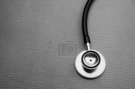 Photo for Head of stethoscope put at the rignt side of background,abstract art design background,black and white tone,blurry light around - Royalty Free Image