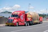 Tillamook, OR / USA - June 23 2018: Truck carrying fake giant idaho potato parked at the side of the road.