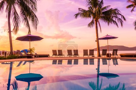 Photo for Beautiful outdoor view with umbrella and chair around swimming pool in luxury hotel and resort at sunrise time for travel and vacation - Royalty Free Image