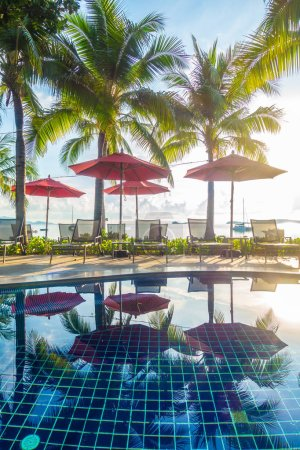 Photo for Beautiful luxury outdoor swimming pool with umbrella and chair in hotel and resort for travel and vacation - Royalty Free Image