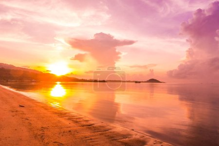 Photo for Beautiful outdoor view with tropical beach and sea at sunrise time for holiday travel and vacation - Royalty Free Image