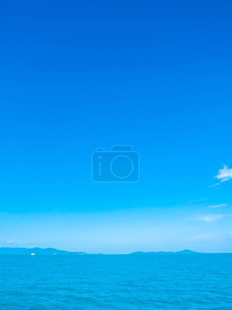 Beautiful sea and ocean on white cloud and blue sky background with copy space for text