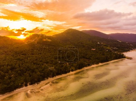 Aerial view of beautiful tropical beach and sea in island at sunset time for travel and vacation