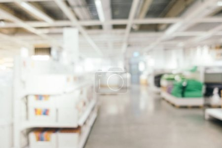 Abstract blur furniture decoration and warehouse store interior for background