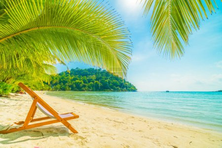 Photo for Chair on the Beautiful tropical beach and sea with coconut palm tree in paradise island for travel and vacation - Royalty Free Image