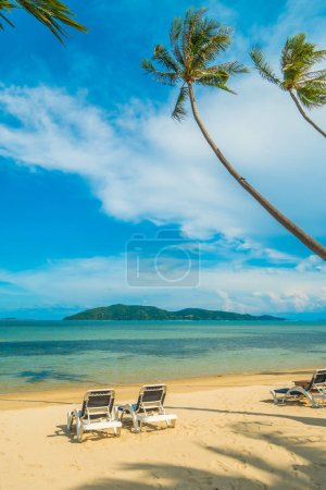 Photo for Beautiful tropical beach and sea with coconut palm tree and chair in paradise island - Royalty Free Image