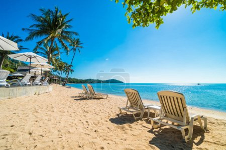 Photo for Beautiful tropical beach and sea with chair on blue sky for travel and vacation - Royalty Free Image