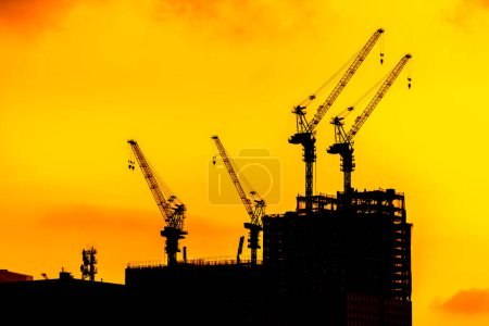 Photo for Beautiful Silhouette crane under construction building at sunset time - Royalty Free Image