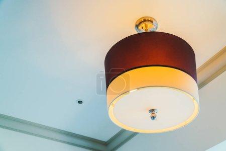 Beautiful ceiling light lamp decoration interior of hotel bedroom