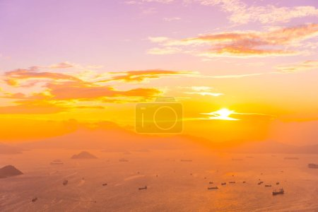 Photo for Beautiful colorful sunset in hong kong city skyline with sea and ocean bay - Royalty Free Image