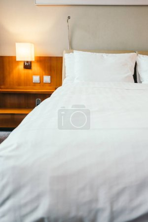 White pillow on bed decoration in hotel bedroom interior