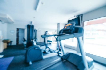 Abstract blur and defocused gym and fitness equipment interior for background