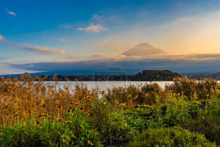 Beautiful landscape of mountain fuji with maple leaf tree around lake in autumn season at sunset time Yamanashi Japan
