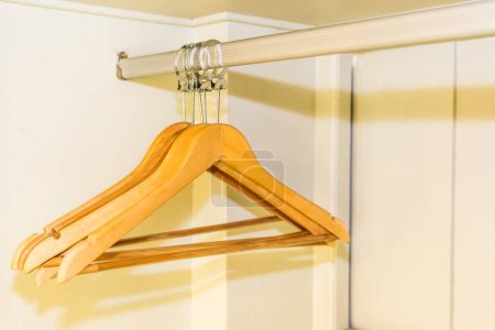 Photo for Clothes hanger with out clothes in closet - Royalty Free Image