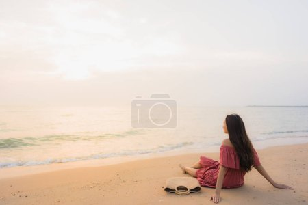 Photo for Portrait beautiful young asian woman happy smile leisure on the beach sea and ocean at sunset or sunrise for vacation travel - Royalty Free Image