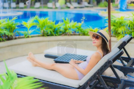 Photo for Portrait beautiful young asian women happy smile relax around outdoor swimming pool in hotel resort for travel vacation - Royalty Free Image