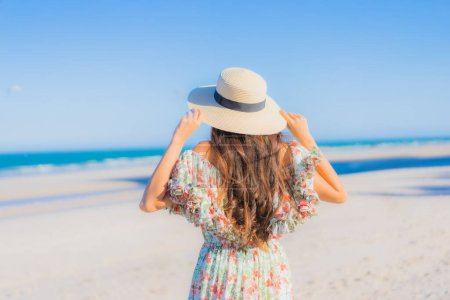 Photo for Portrait beautiful young asian woman happy smile relax around tropical beach sea ocean on blue sky for leisure - Royalty Free Image