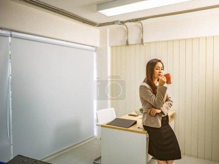 Modern business women hold her coffee cup or mug,b...