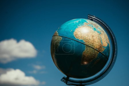 globe with sky, rossian language glob, clouds on sky, environment concept, world globe,