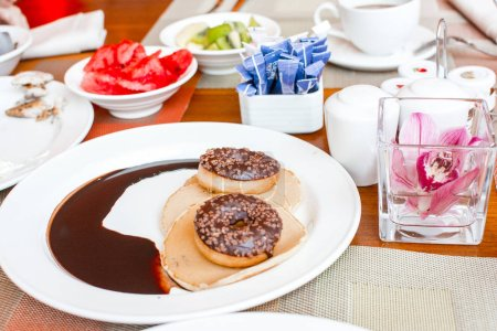 Photo for Breakfast on plates in the form of a smiley with donuts - Royalty Free Image
