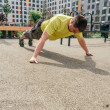 Determined Sportsman during fitness training outdo...